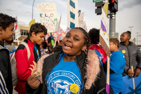 Sixth grader Anaya Hall from Springfield advocates for after school programs on Thursday, Oct. 24, 2019 in downtown Battle Creek, Mich.