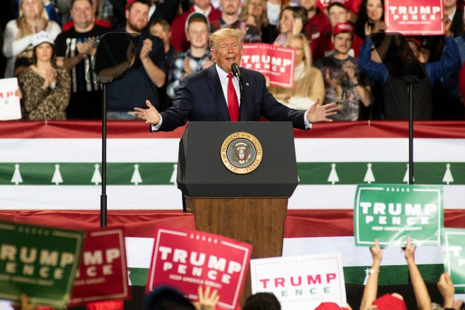 """President Donald Trump delivers remarks during his """"Merry Christmas"""" rally on Dec. 18 at Kellogg Arena in downtown Battle Creek, Michigan. The rally took place as the House of Representatives voted to impeach Trump for abuse of power and obstruction of Congress."""