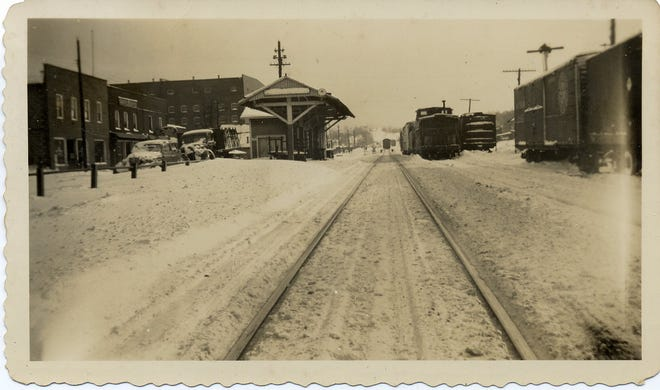 The Swannanoa Train Depot and the businesses along Railroad Street, including Beacon Manufacturing, are pictured in 1936.
