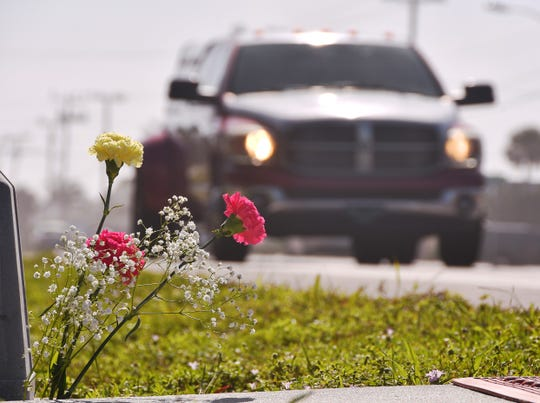 Carnations and baby's breath flowers are displayed near the State Road A1A crosswalk at Ellwood Avenue in Satellite Beach where a 12-year-old girl was fatally struck