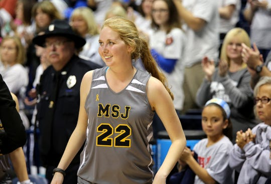 Lauren Hill, 19, a freshman at Mount St. Joseph University who is battling an inoperable rare form of brain cancer, prepares to receive the Wilma Rudolph Student Athlete Achievement Award after her first college basketball game. The Lions took on Hiram College at Xavier University's Cintas Center.