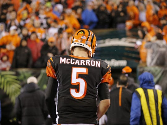 Cincinnati Bengals quarterback AJ McCarron (5) heads for the locker room after the fourth quarter of the NFL AFC wild-card playoff game between the Cincinnati Bengals and the Pittsburgh Steelers at Paul Brown Stadium in downtown Cincinnati on Saturday, Jan. 9, 2016.