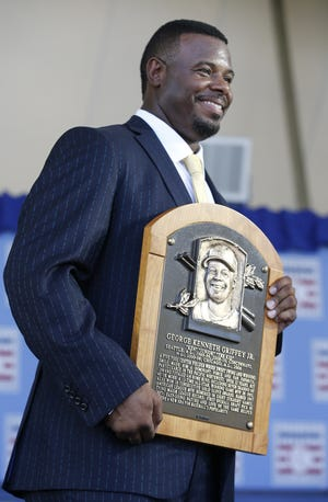 Former Seattle Mariners and Cincinnati Reds player, Ken Griffey Jr., poses with his plaque at the induction ceremony into the National Baseball Hall of Fame, July 24, 2016, in Cooperstown, N.Y.