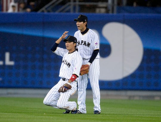 March 21, 2017; Los Angeles, CA, USA; Japan infielder Hayato Sakamoto (6) reacts with Japan outfielder Shogo Akiyama (55) after he catches a fly ball against USA to end the top of the fourth inning during the 2017 World Baseball Classic at Dodger Stadium. Mandatory Credit: Gary A. Vasquez-USA TODAY Sports