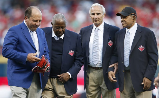 From left: Johnny Bench, Hank Aaron, Sandy Koufax and Willie Mays walk off the field after being honored as the greatest living baseball players prior to the 2015 MLB All-Star Game, Tuesday, July 14, 2015, at Great American Ball Park in Cincinnati.