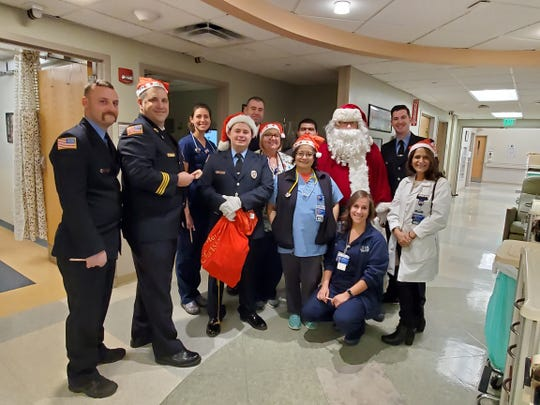 The Summit Fire Department and its FMBA Local 54 members escorted Santa Claus to Overlook Medical Center for an annual Christmas Eve visit with pediatric floor patients.