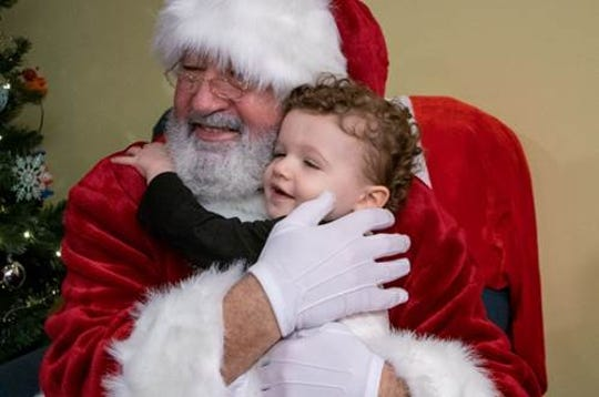 Children at Ronald McDonald House of Central & Northern New Jersey celebrated with Santa Claus during their holiday party.