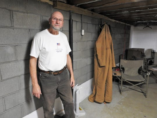 Wilson McCoy in front of his repaired basement wall, which was destroyed by June flooding in West Lafayette. McCoy feels the village did a good job in the aftermath and his biggest concern now is work on the Kirk Street drain to prevent such future flooding.