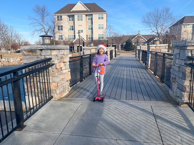 Mathilde Butler scoots at Jordan Creek  before going to a movie with her parents: Heidi Mannetter and Matt Butler on Christmas Day. Wednesday saw record highs in Des Moines and much of south central Iowa.