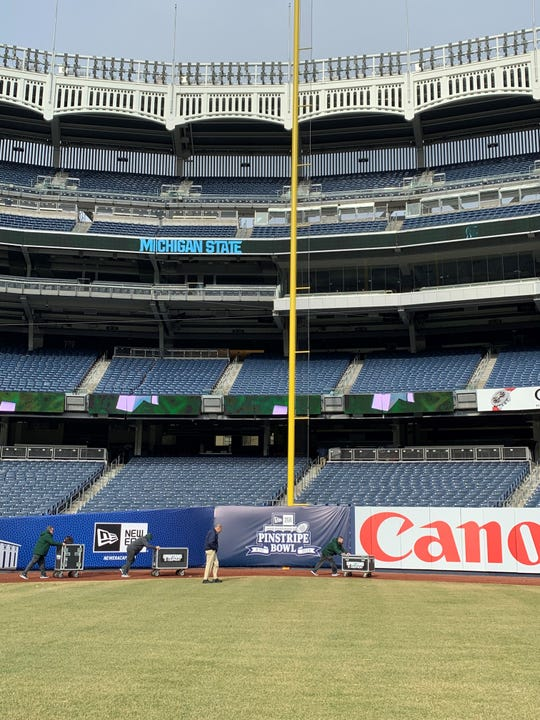 Michigan State football's equipment staff prepares for a walk-through practice Thursday, Dec. 26, 2019 at Yankee Stadium in New York for the Spartans' Pinstripe Bowl game against Wake Forest on Friday.