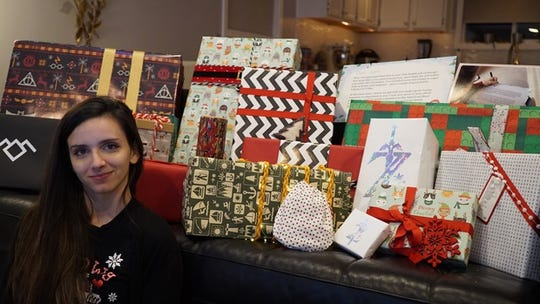 Shelby shows off her gifts from Secret Santa Bill Gates. This is her 95th RedditGifts exchange.