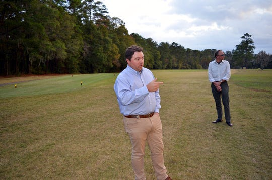 Jay Revell, left, who serves as the historian for the Capital City Country Club, visits the 7th hole of the country club on Dec. 16, 2019, with Jeffrey Shanks, right, an archaeologist with the National Park Service in Tallahassee, Fla. Revell says the country club's board is considering how to memorialize dozens of slaves buried in an unmarked cemetery near the 7th hole women's tee. The golf course is located on land that was once one a former plantation.