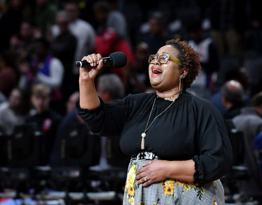 LaShell Renee Griffin is in her eighth season singing the national anthem before Pistons home games.