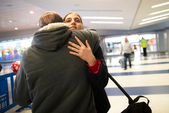 In this Dec. 3, 2019, photo, Mohammed Hafar hugs his daughter Jana after she arrives at JFK Airport in New York. Jana had been forced by President Donald Trump's travel ban to stay behind in Syria for months while her father, his wife and son Karim started rebuilding their lives in Bloomfield, N.J., with no clear idea of when the family would be together again. Mohammed was part of a federal lawsuit filed in August of this year over the travel ban waiver process.