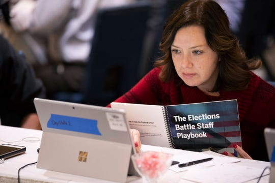 Mandy Vigil, from New Mexico, works during an exercise run by military and national security officials, for state and local election officials to simulate different scenarios for the 2020 elections, in Springfield, Va.