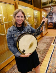 Maureen Feighan with her father's banjo.