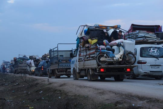 Truckloads of civilians flee a Syrian military offensive in Idlib province on the main road near Hazano, Syria, Tuesday, Dec. 24, 2019. Syrian forces launched a wide ground offensive last week into the northwestern province of Idlib, which is dominated by al-Qaida-linked militants.