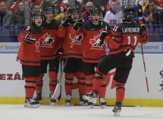 Alexis Lafreniere, right, celebrates Canada's fourth goal during the U20 Ice Hockey Worlds game against the United States in Ostrava, Czech Republic.