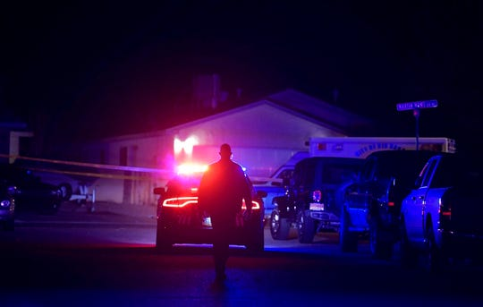Authorities work the scene where multiple people were found dead in a home in the Northern Meadows subdivision, Wednesday, Dec. 25, 2019, in Rio Rancho, N.M.