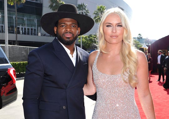 In this July 10, 2019 file photo, P.K. Subban, left, of the New Jersey Devils, and Lindsey Vonn arrive at the ESPY Awards at Microsoft Theater in Los Angeles.