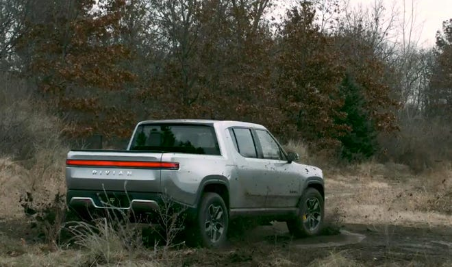 With a motor at each wheel, the Rivian pickup can spin left- and right-side wheels simultaneously in opposite directions to turn donuts in its own tracks like an Army tank.