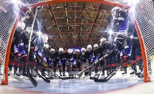 Team USA gather in the goal crease before a 4-1 win over Finland in the women's world U18 championships.