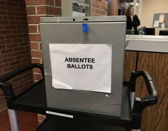 Michigan's new no-reason absentee voting option is expected to increase the use of absentee voting but could diminish the state's significance in the March presidential primary.