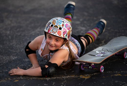 Lola Smith, 8, of Newburgh, Ind., rolls off her skateboard while trying to learn how to do a coffin during the Evansville Girls' Skate Day at Killer Skate Park & Shop Monday evening.