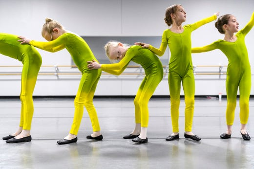 Little ballerinas learn how to become a caterpillar during rehearsal for their upcoming show Alice's Adventures in Wonderland at The School of Ballet Indiana in Evansville, Ind., Saturday, April 6, 2019. The ballerinas pictured are Emma Roemke, from left, Zoey Wildt, Selah Schmidt and Clara Gilbert.