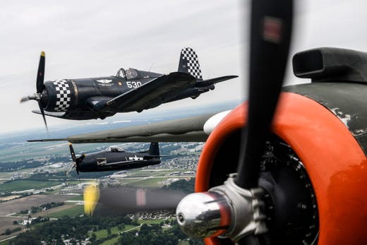 """A Goodyear FG-1D Corsair and Grumman F8F Bearcat fly alongside the B-25J """"Show Me"""" owned by the Missouri Wing of the Commemorative Air Force during a practice run for the ShrinersFest Air Show in Evansville, Ind., Friday, June 21, 2019."""