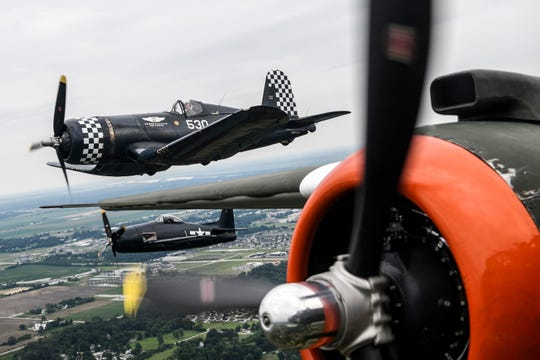 "A Goodyear FG-1D Corsair and Grumman F8F Bearcat fly alongside the B-25J ""Show Me"" owned by the Missouri Wing of the Commemorative Air Force during a practice run for the ShrinersFest Air Show in Evansville, Ind., Friday, June 21, 2019."