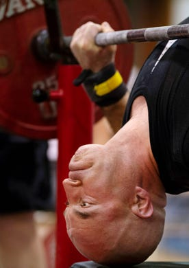 Michael Bennett from Great Britain positions himself for an attempted lift during the bench press competition at the World Drug-Free Powerlifting Federation's Single Event World Powerlifting Competition at the JFK Center in Henderson, Ky., Saturday morning. (Shot 6/8/19(
