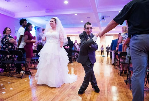 Wade Conway fist bumps a friend as Kendra Creek and he officially become man and wife at their wedding at the City View in Sterling Square Saturday evening, September 7, 2019.