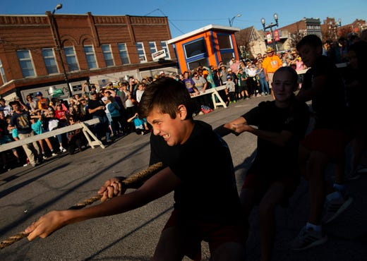 Kylian Wathen, 13, helps pull his St. Wendel team to a victory at the 98th West Side Nut Club Fall Festival Tuesday evening.