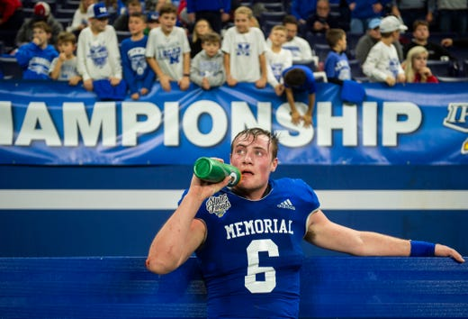 Fans scream from the stands at Memorial's Brock Combs (6) after he scored a touchdown at the Evansville Memorial vs East Noble IHSAA Class 4A State Championship game at Lucas Oil Stadium in Indianapolis, Ind., Saturday, Nov. 30, 2019.