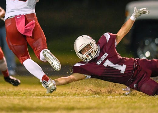 Henderson's Colton Evans (1) grabs a hold of McCracken County's Hunter Bradley (16) as the Henderson County Colonels play the McCracken County Mustangs at Colonel Stadium Friday evening, October 25, 2019.