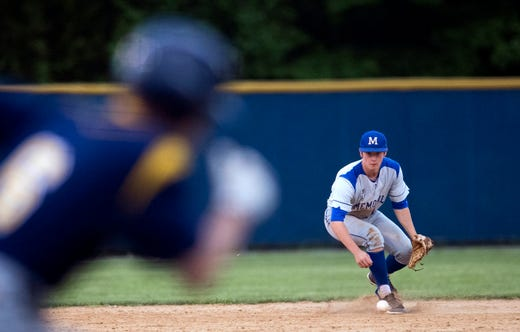 Memorial's Craig Karcher (14) fields a grounder while a runner speeds to first during the SIAC Castle Knights vs Memorial Tigers baseball game in Newburgh, Ind. Wednesday, May 15, 2019.
