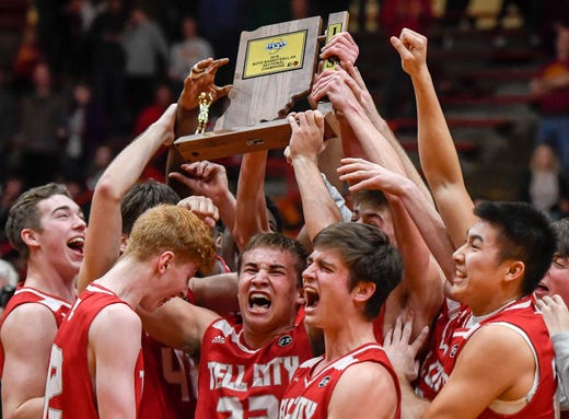The Marksmen celebrate with the championship trophy after defeating the Mater Dei Wildcats in the Class 2A Sectional Championship at Huntingburg's Memorial Gym Saturday, March 2, 2019.