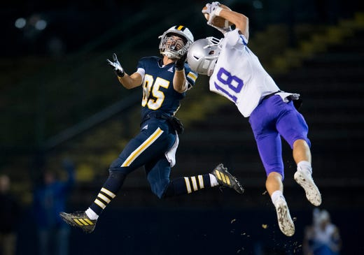 Bloomington South's Maddix Blackwell (18) intercepts the pass to Castle's Nick Avery (85) during the IHSAA Class 5A sectional championship game at John Lidy Field in Newburgh, Ind., Friday, Nov. 8, 2019.