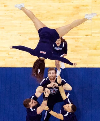 The Belmont Cheerleaders look to catch their flyer during a halftime performance at the Ford Center in Evansville Friday afternoon. The Belmont Bruins women's basketball team beat the Tennessee Tech Golden Eagles in the semifinal game of the Ohio Valley Conference Basketball Championships. (Shot 3/8/19)