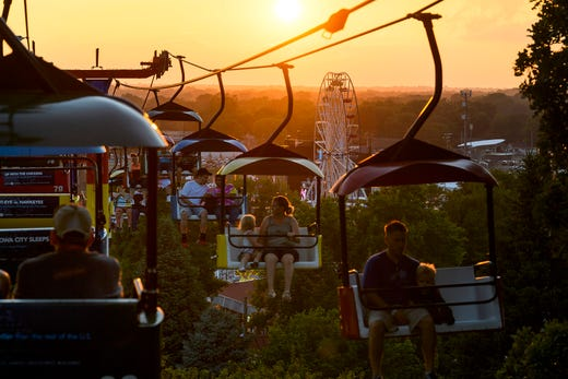 The sun sets as fairgoers ride the Sky Glider on the fourth day of the Iowa State Fair in Des Moines, Iowa, Sunday, Aug. 11, 2019. According to the Iowa State Fair's website, 108,283 attended the fair on Sunday.