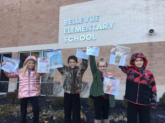 In December, teachers from Bellevue Elementary School hid books throughout the community. Children who found them brought them to school.