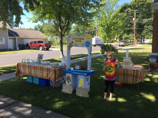 Sky Schienberger of Casco sold lemonade at her grandparents' place to raise money to buy supplies for children in need at Algoma Elementary School.