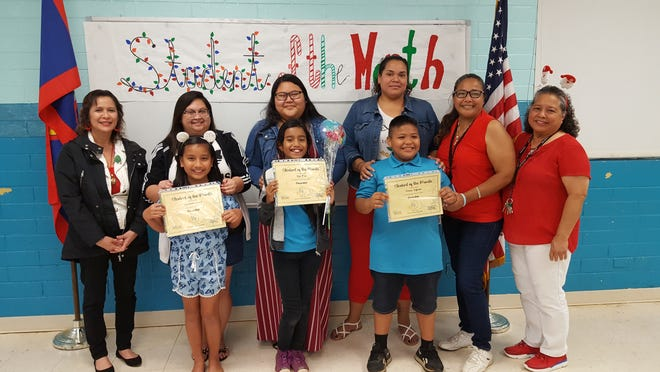 Guahan Academy Charter School's November student of the month awardees on Dec. 19. Pictured in front row: Ayrianna Cruz; Ryu Mori and Prince Taijeron. Back row: Lynda Hernandez-Avilla; Jennie Barroga; Ritacia Fegurgur; Ashlynn Manuel; Remy Taijeron and Mary Mafnas.