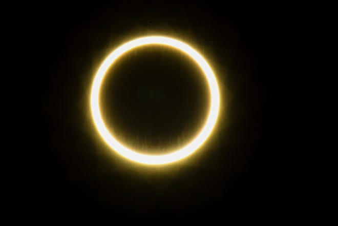 A ring of fire, or annulareclipse, is produced as the moon passes directly between the Earth and the sun in the skies over Guam on Thursday, Dec. 26, 2019.