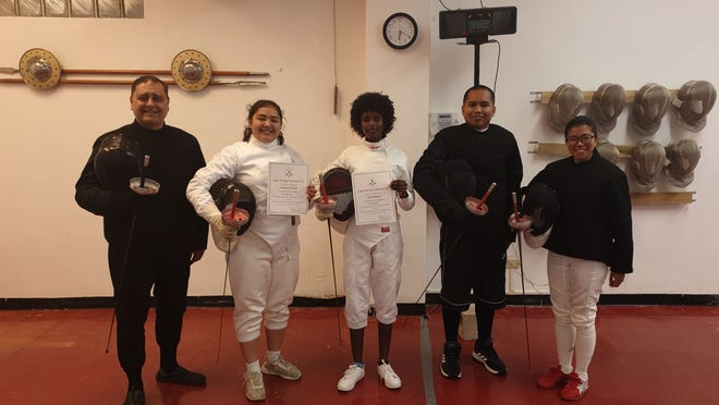 The Guam Fencing Federation presented certificates to its fencers who completed the basic epee course that held Sept. 3 to Dec. 10, 2019.  From left: Coach Anthony R. Camacho, epee fencers Belladona Kosack and Ruth Rahmani, and Assistant Coaches Christian Limtiaco and Jane Dorion.