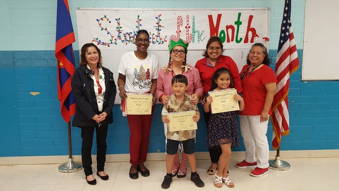 Guahan Academy Charter School's November student of the month awardees on Dec. 19. Pictured: Frederico Dela Cruz and Lauran Damian. Back row: Lynda Hernandez-Avilla; Julie Willter; Adelin Unpingco; Gemma Bustamante and Mary Mafnas. Not pictured: Kimora-Lynne Kawamoto