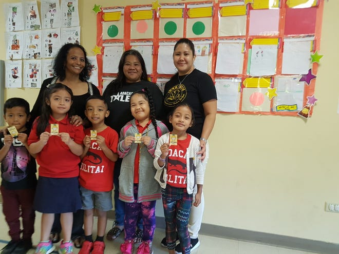 The following Adacao Elementary School kindergarten shining stars of A107, Mary Cruz's class, were recognized for perfect attendance for first semester. Front row from left:  Zayne Alig, Margaret Calalang, Caden Aguon, Redelaya Aisek, and Hailey Piyebulmal.   Back row: Mary Cruz, teacher, Christine Quitugua, PTO president, and Jolene Naputi, PTO vice-president