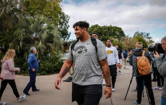 Iowa junior right tackle Tristan Wirfs leads the Iowa Hawkeyes football team to the entrance of the San Diego Zoo on Wednesday, Dec. 25, 2019, in San Diego, Calif.