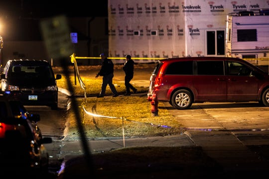 Police investigate a scene of a shooting, Thursday, Dec. 26, 2019, at an apartment complex on Boston Way in Coralville, Iowa.